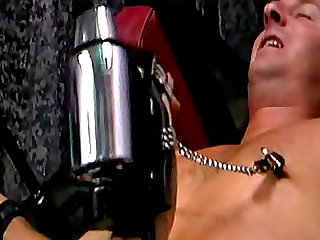 Chastity belt on man in dungeon