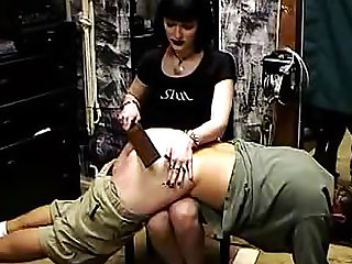 Sub guy and girl spanked hard in dungeon