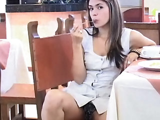 Teen Latina shows an upskirt in a public place