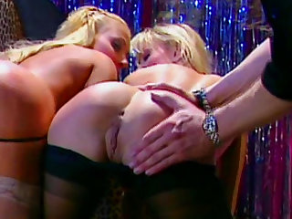 Blonde pole dancers perform striptease