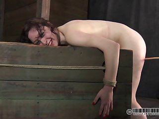 Tied bondage brunette pleasured with nice toys in BDSM
