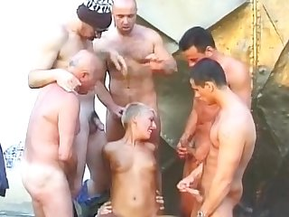 Fabulous bukkake lady with short hair is doing awesome blowjobs to a couple of guys.