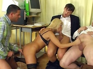 Office fuck of milf chick Nikki, which is having her shaved pussy fucked in doggy style by a bunch of office dudes.