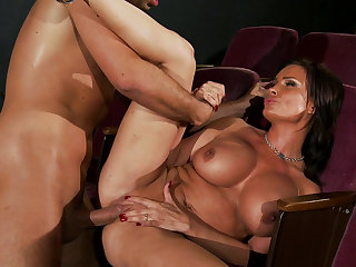 Hot tanned brunette with perfect shape Diamond Foxxx is fucking with Keiran Lee in the cinema