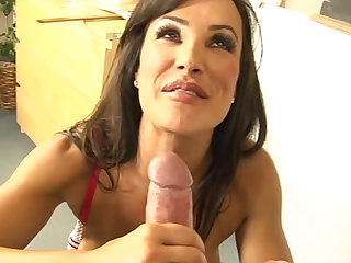 In the classroom set we watch Lisa Ann suck a dick and see her take a cumshot on her fake tits.