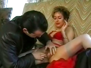 He licks and fingers her arousing hairy vagina in the retro porn before bending her over.