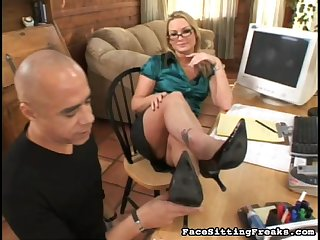 A curvy blonde milf in glasses and as satin blouse has him suck her toes and high heels.