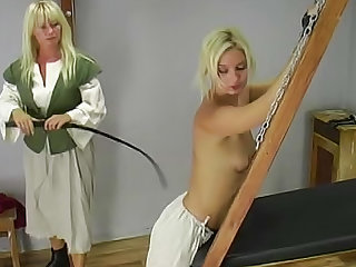 Watch this severe blonde mistress lashing her hanging slave with small tits in this femdom video. Get ready to see this slave getting some serious pain.
