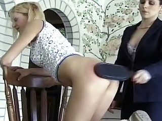 Get ready for rough punishment in this femdom video. This brunette MILF mistress is spanking and inflicting pain to her slaves.