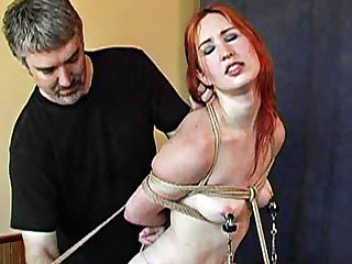 Redhead definitely enjoys the process! She's getting bound and slapped really hard and she likes it!