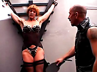 Horny milf with huge ass gets punished. She is dressed in sexy black lingerie and stockings. Enjoy