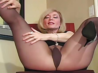 Good-looking blonde MILF with awesome ass is wearing her favorite pantyhose and showing some stunning poses.