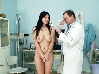 Hardcore brunette with natural boobies and tattoos Roxy Taggart is getting naked in the medicine office