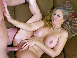 Amazing mom, Julia Ann, moans and shakes her big naturals in a series of jaw dropping hardcore couch sex along her step son, a guy with the perfect cock