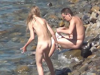 Cute little sisters has nice asses and tanned bodies on the nudist beach in a hot voyeur scene