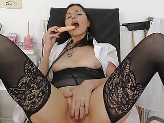 Alluring chick with nice face is getting her shaved pussy stretched in the medical chair