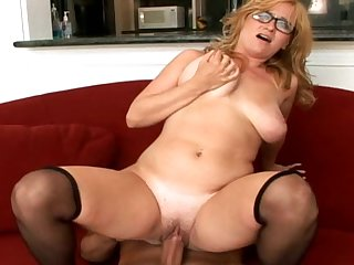 Perverted blonde with shaved pussy and stockings is getting drilled in her innocent face and puss
