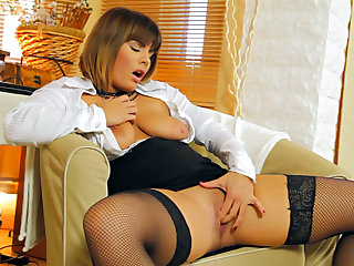 Amy Wild is wearing black stockings while digitally stimulating her clit and inserting her new toy in her pussy.