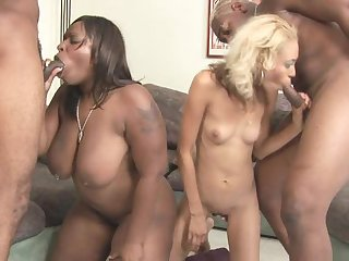 Alluring interracial fuck with two sexy bitches and giant hard dicks that are loaded with jizz