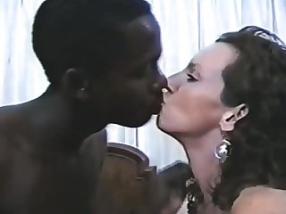 Vintage interracial tanned mature and her man