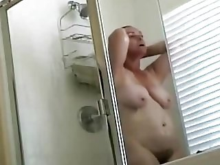 mature lady spied in a shower
