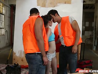 Cute slut in a sports bra bangs two construction workers