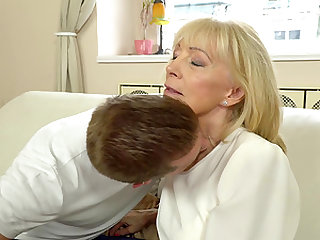 Mature blonde Szuzanne spreads her legs for a hard cock