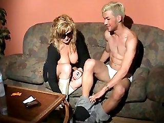 Mature woman fucks a cock craving fellow with a strap-on