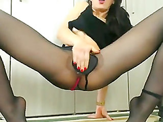 Babe is rubbing her hot pussy in black sexy stockings