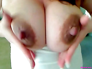 Hot pregnant lady with huge belly and dripping breasts