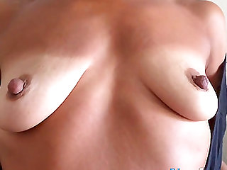 Mature Nina shows his sagging breasts and excited nipples