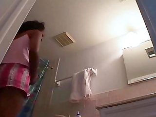 My girlfriend unware of the hidden camera in our bathroom.