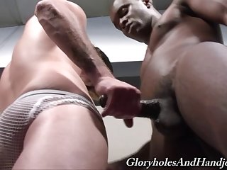 White guy grabs a big black cock and jerks it off
