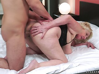 Chubby granny gets fucked by a younger stud and nearly passes out