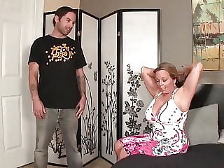 Big boobs stepmom gives son a hand