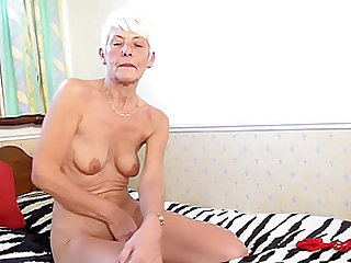 Short haired mature amateur British granny Lyndy strips