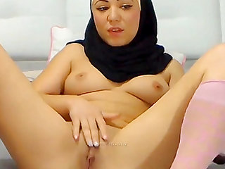 Horny Arab babe fucks her pussy with a black dildo on webcam