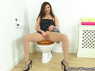 UK milf Kitty Cream gets hot and bothered on toilet
