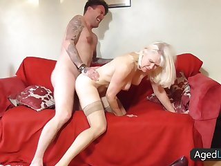 Moaning mature blonde gets pounded from behind