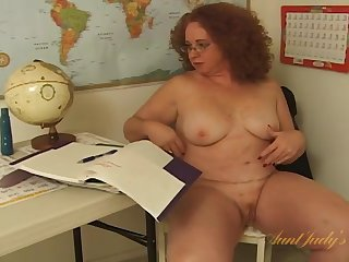 Fat teacher strips and fucks a toy for her student