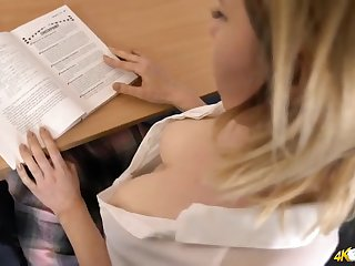 Schoolgirl unbuttons her blouse and flashes her tit flesh