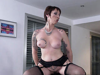Tattooed gilf rides big black cock after bj
