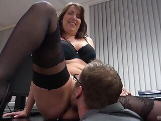Daphne Laat rides her colleague in the office while her boobs bounce