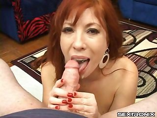 Cute redheaded milf is all about sucking and stroking dick