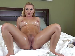 Solo Katja Kassin in bed for live double dildo penetration
